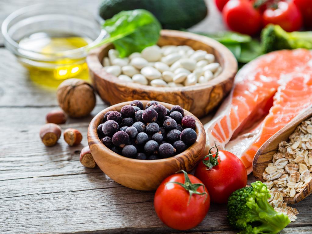 Como é que os alimentos podem reduzir ou aumentar o risco de doença?